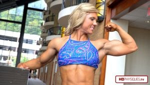 Simply phenomenal. Carli, the NEW IFBB PRO, sporting some HOT ripped muscle, in a super HOT outfit - get this amazing video today!