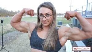 HUGE and strong, Beefnuggette does some sexy posing outdoors on the track.  Get this new video today in her Clips Studio!
