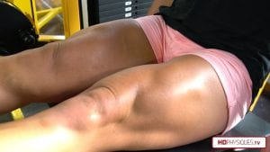 Christine's massive quads, with leg extensions and flexing - get it today in her Clips Studio at HDPhysiques.TV!