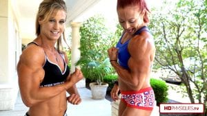 Big-armed Alli Schmohl holding her own against taller and bigger Katie - look at those powerful biceps!  Get this hot video today by clicking here!