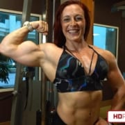 Katie's MASSIVE BICEPS are Back on the ATTACK!   HOT Sweaty Sexy New Video Available!
